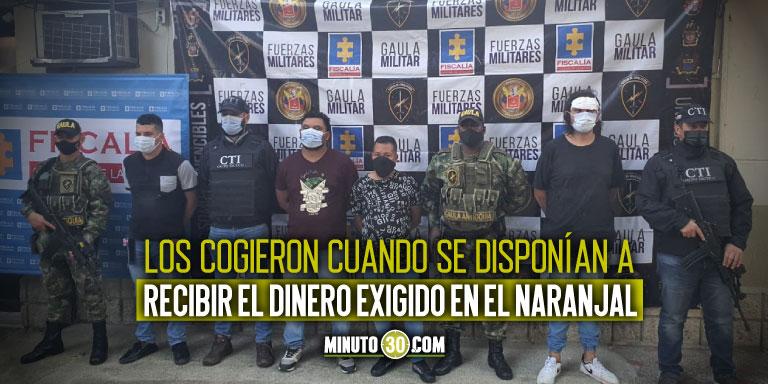 A la carcel cuatro hombres que se hacian pasar por policias para extorsionar a un comerciante en Medellin