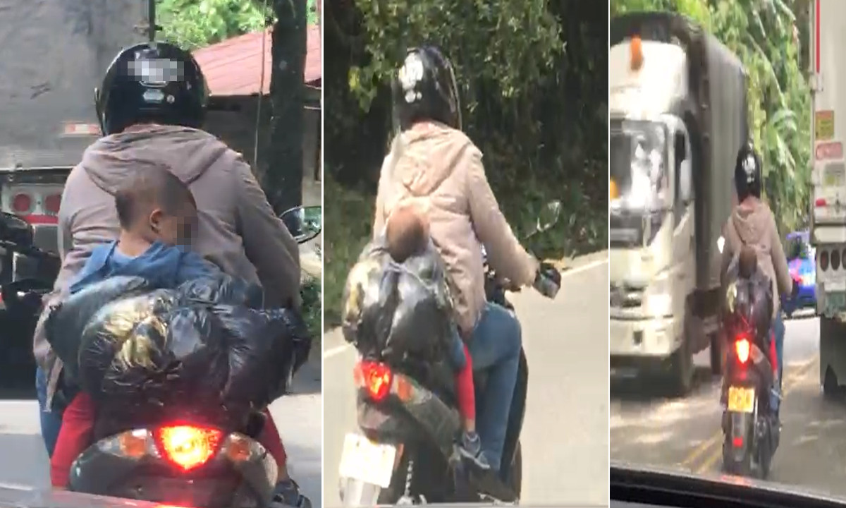 Video: ¡Irresponsable! En Antioquia un motociclista llevaba a un niño dormido y sin casco