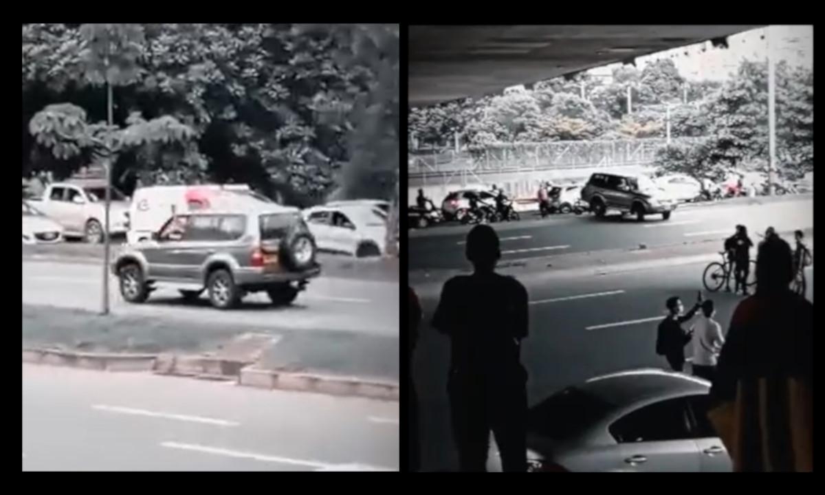 [Video] Conductor hizo tiros al aire y se pasó por encima del separador de la vía durante manifestaciones en Medellín