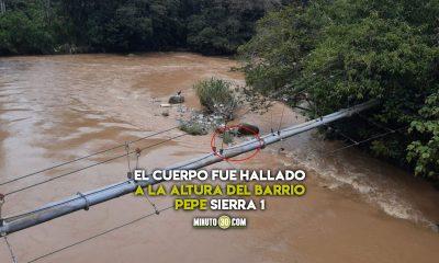 Cuerpo en el río Medellín, por Barbosa