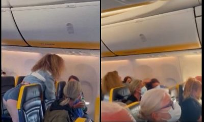 mujer tapabocas vuelo