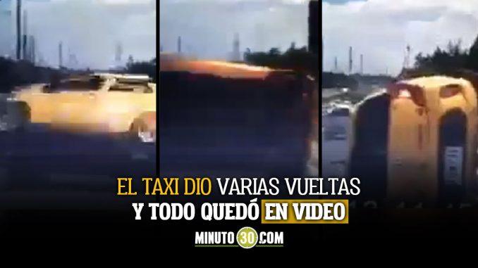 Taxi terminó volcado en pleno puente de Cali