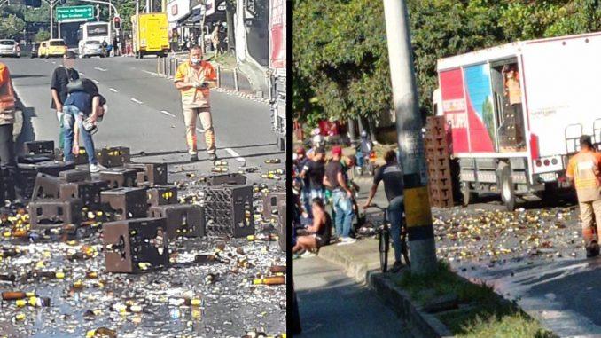 Le cayeron varias cajas de cervezas encima a un motociclista en la Av. 80 de Medellín tras accidente de camión repartidor
